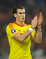 BRUSSELS, BELGIUM - Sunday, November 16, 2014: Wales' Gareth Bale celebrates a point and staying top of the group after a goal-less draw against Belgium during the UEFA Euro 2016 Qualifying Group B game at the King Baudouin [Heysel] Stadium. (Pic by David Rawcliffe/Propaganda)