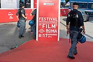 Roma 14 Novembre 2013<br /> I movimenti per la casa protestano al Film Fest all'Auditorium  per i numerosi sfratti che ci sono a Roma, e per  lo sfratto di questa mattina di Abdou la moglie con tre bambini, che dopo lo sfratto da parte della polizia non hanno ricevuto nessuna assistenza.Police oversees the Red Carpet of the Auditorium della Musica in Rome during the Film Festival