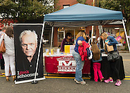 "Merrick, New York, USA. 13th September 2014. the Merrick Library booth at the 23rd Annual Merrick Fall Festival & Street Fair in suburban Long Island gave out 'What do you geek?' stickers to fair visitors. The stickers are by the non-profit nonpartisan Geek the Library organization. U.S. Actor Brian Dennehy appears on the poster that reads ""I geek schooners"" as part of the library advocacy campaign."