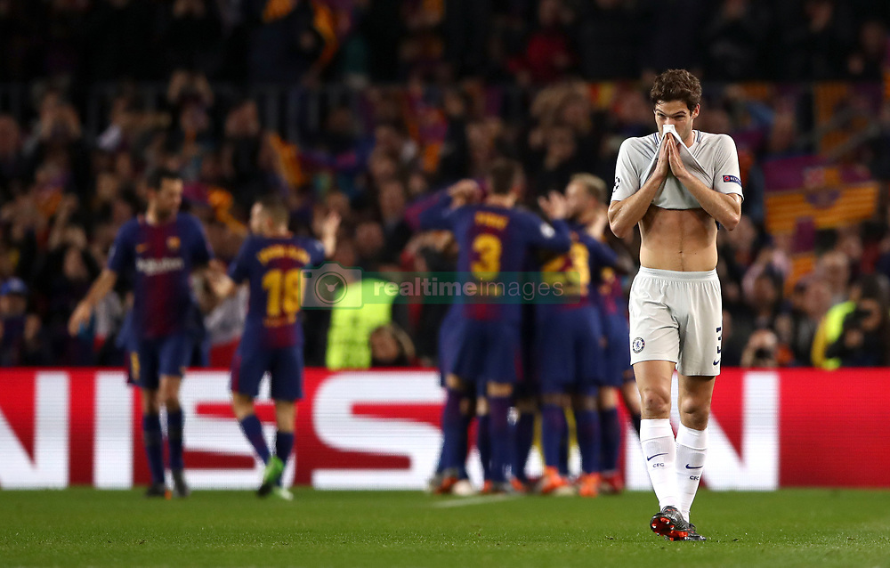 Chelsea's Marcos Alonso reacts after FC Barcelona's second goal