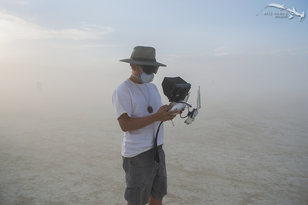 Eric Cheng flies a DJI Phantom 2 out on the playa (photo: Gerard Mattimoe) Burning Man 2014.