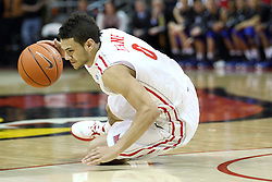 12 January 2013:  Kaza Keane stumbles to the floor but keeps up the dribble during an NCAA Missouri Valley Conference mens basketball game Where the Bulldogs of Drake University beat the Illinois State Redbirds 82-77 in Redbird Arena, Normal IL