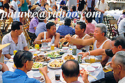 Villagers having meal in Tinhau, matsu festival, Tapmun island, Hong Kong, china