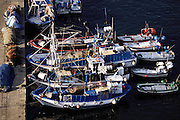 Fishing boats in the harbor and nets on the dock at Barcelona, Spain, seen from the aerial tramway.