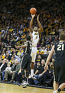 February 27 2013: Iowa Hawkeyes guard/forward Roy Devyn Marble (4) puts up a shot over Purdue Boilermakers guard Ronnie Johnson (3) during the first half of the NCAA basketball game between the Purdue Boilermakers and the Iowa Hawkeyes at Carver-Hawkeye Arena in Iowa City, Iowa on Wednesday, February 27 2013.