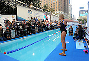 "Long-distance swim legend Diana Nyad stretches before starting her 48-hour continuous ""Swim for Relief"" to support Hurricane Sandy recovery efforts, Tuesday, Oct. 8, 2013, in New York's Herald Square.  The swim is raising funds for AmeriCares, a non-profit relief organization, with P&G brands such as Duracell, Tide and Secret underwriting the production costs to maximize the funds donated.  (Photo by Diane Bondareff/Invision for P&G/AP Images)"