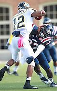 Samford defensive back Jaquiski Tartt  (27) wraps up Appalachian State quarterback Jamal Jackson (12) at Seibert Stadium in Homewood, Ala., Saturday, Oct 13, 2012. (Marvin Gentry)