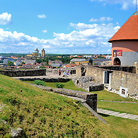 Brief History of the Castle of Eger in Eger, Hungary <br /> In 1001 A.D., Stephen I of Hungary &ndash; also called King Istv&aacute;n &ndash; commissioned a Romanesque cathedral on what is now called Castle Hill. After the Mongol attack in 1241, Bishop Lambert of Eger ordered the construction of a surrounding fortress in 1248. The citadel allowed Eger to prosper until the Turks invaded in 1552. The resulting Siege of Eger became the country&rsquo;s symbolism of heroism. For five brutal weeks, Istv&aacute;n Dob&oacute; and about 2,300 defenders thwarted an assault on the castle by 40,000 Ottoman soldiers. One key to their success was the 10 foot wide bastions and walls. The remnants of the defense seen in front of the round tower date back to the mid-1500s. Beneath them is a labyrinth of tunnels.