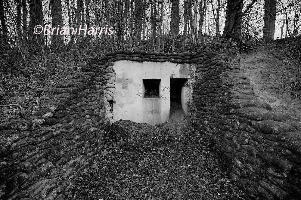 Ypres-Ieper WW1 Battlefield, 1914-1918, Belgium. Lettenberg British Dugouts, Kemmel, Ypres, Flanders, Belgium. February 2014<br /> Lettenberg British Dugouts built in 1917  into the side of a low hill near the higher Kemmelberg, Kemmel, to the south of Ypres. The four dugouts were buried for 80 years and were excavated in 2004  by the Battlefield Archaeology Association in Flanders. The faded remains of a Red Cross can just be seen. One of the dugouts is now used as a bat sanctuary.