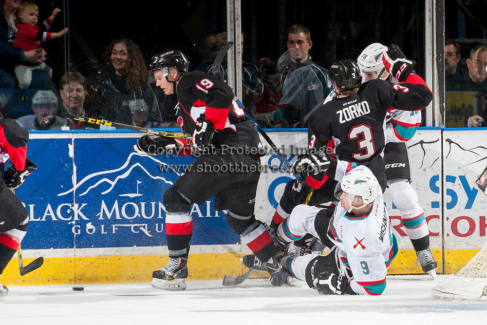KELOWNA, CANADA - MARCH 9: Tanner Wishnowski #9 of Kelowna Rockets gets checked to the ice by Shane Collins #19 of Prince George Cougars on March 9, 2016 at Prospera Place in Kelowna, British Columbia, Canada.  (Photo by Marissa Baecker/Shoot the Breeze)  *** Local Caption *** Shane Collins; Tanner Wishnowski;