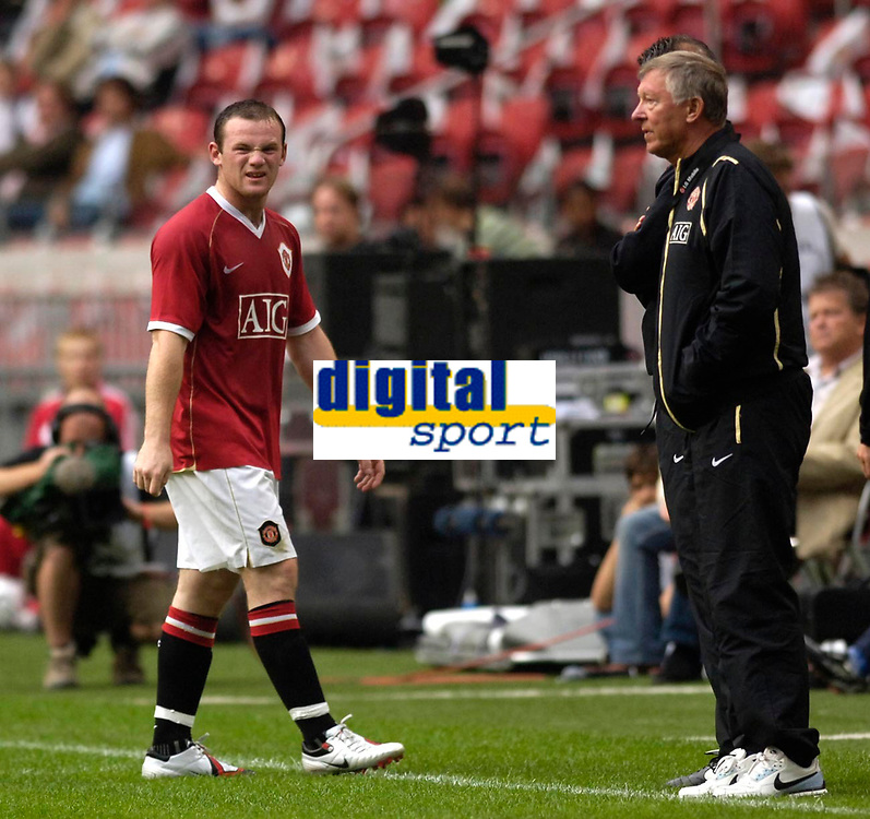 Photo: Daniel Hambury.<br />Manchester United v FC Porto. Amsterdam Tournament. <br />04/08/2006.<br />Manchester's Wayne Rooney leaves the pitch after being sent off watched by manager Sir Alex Ferguson.