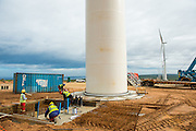 Construction of a wind turbine, foundation and first section of the tower
