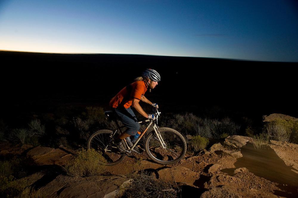Jon Hansen of St. George, Utah climbs a rocky section as desk settles in.