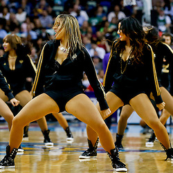 Mar 20, 2013; New Orleans, LA, USA; New Orleans Hornets Honeybees perform during the second half of a game against the Boston Celtics at the New Orleans Arena. The Hornets defeated the Celtics 87-86. Mandatory Credit: Derick E. Hingle-USA TODAY Sports