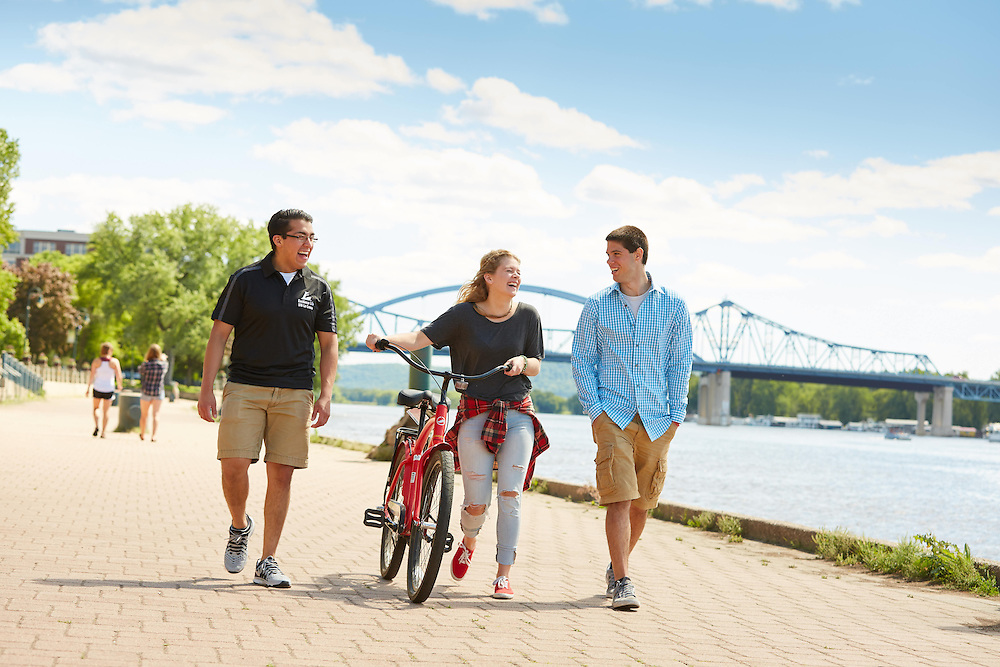 Activity; Socializing; Buildings; Downtown; Location; Outside; People; Woman Women; Man Men; Student Students; Summer; June; Time/Weather; day; Type of Photography; Candid; Lifestyle; UWL UW-L UW-La Crosse University of Wisconsin-La Crosse; Cass Street Bridge; Riverside Park; Diversity; bike
