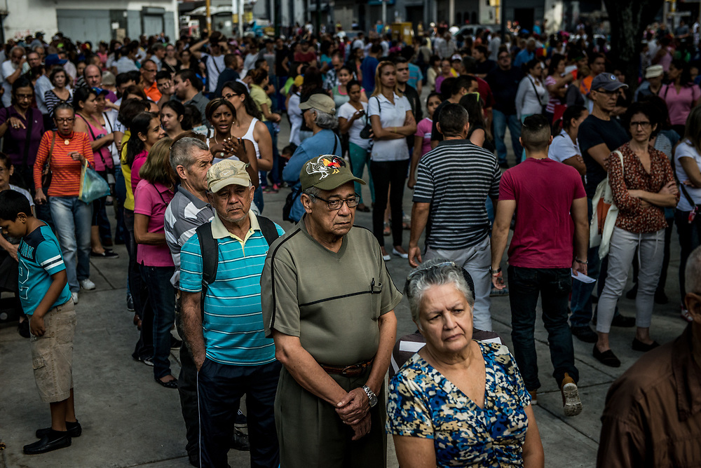 "CARACAS, VENEZUELA - JULY 16, 2017:  Millions of Venezuelans showed up at polling stations at home and abroad on Sunday for a vote unlike any other in this nation's history. They cast ballots with three yes or no questions that were drafted with the aim of weakening President Nicolás Maduro's legitimacy as he sets out to convene a constituent assembly later this month that opponents see a as a power grab by an increasingly unpopular leader. The exercise, known as a ""popular consultation,"" was organized by a slate of opposition parties that dominate the national assembly. Organizers hope that a large turnout and lopsided result will widen rifts within the ruling party and deepen the government's international isolation, undermining Mr. Maduro's plan to have a hand-picked constituent assembly draft a new charter in coming weeks.  Voters were asked whether they reject the plan to hold a constituent assembly that has not been approved by voters; whether they wanted the country's armed forces to defend the current constitution and the decisions of the opposition-run national assembly; and whether they wanted free elections to pick a new ""national unity government."" While Mr. Maduro's government is widely expected to ignore the result of the vote, organizers hope it deepens its international isolation and invigorates a protest movement that has gained momentum over the past couple of months. For ordinary Venezuelans, it represented the first opportunity to cast ballots since the 2015 legislative election that ended Mr. Maduro's party's dominance of the national assembly. The government has postponed every election that was scheduled to take place since then. PHOTO: Meridith Kohut"