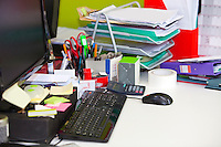 Close-up of real life messy desk in  office