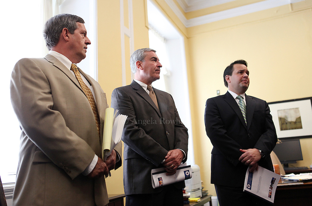(052813  Boston, MA)  Assistant Deputy Auditor Ken Woodland, left, Director of State Audits John Pietrini, and Audit Manager of State Audits listen as State Auditor Suzanne Bump speaks at the State House during a news conference about an audit of the Department of Transitional Assistance, Tuesday,  May 28, 2013. photo by Angela Rowlings.