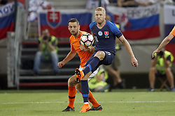 (L-R) Stefan de Vrij of Holland, Adam Nemec of Slovakia during  the International friendly match between Slovakia and The Netherlands at Stadium Antona Malatinskeho on May 31, 2018 in Trnava, Slovakia