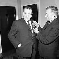 The Minister for Defence Mr Billiard T.D. presents the 1916 survivors medal to An Taoiseach Mr Lemass Govt. April 4 1966.<br /> (Part of the Independent Newspapers Ireland/NLI Collection)
