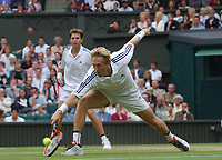 Jonas Bjorkman (Sweden) in action with partner Todd Woodbridge (Australia) in the mens doubles final. Wimbledon Tennis Championship, Day 12, 5/07/2003. Credit: Colorsport / Matthew Impey DIGITAL FILE ONLY