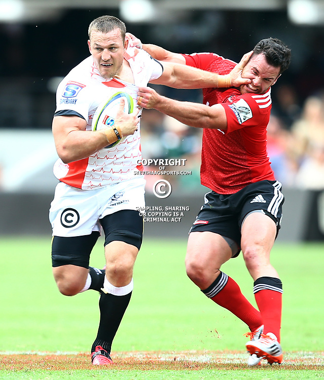 DURBAN, SOUTH AFRICA - APRIL 04:  Jean Deysel (captain) of the Cell C Sharks hands off Ryan Crotty of the Crusaders during the Super Rugby match between Cell C Sharks and Crusaders at Growthpoint Kings Park on April 04, 2015 in Durban, South Africa. (Photo by Steve Haag/Gallo Images)