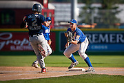 Moline firstbaseman Timmy Wages, right, gets ready to place a tag on Branford's Brendan Shea during the third inning of Friday's American Legion game at Avista Stadium in Spokane, WA.