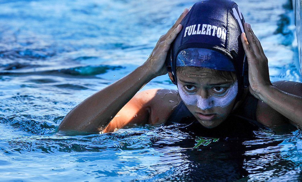 Diana Ramirez of Fullerton College puts on her game cap before the second game of Orange Empire Conference Water Polo Championships. November 3rd, 2016, 10:20am &mdash; Orange Coast College vs Saddleback College &mdash; Women&rsquo;s Waterpolo &mdash; Saddleback College, Mission Viejo, CA<br /> <br /> Photo by Austin Song / Sports Shooter Academy