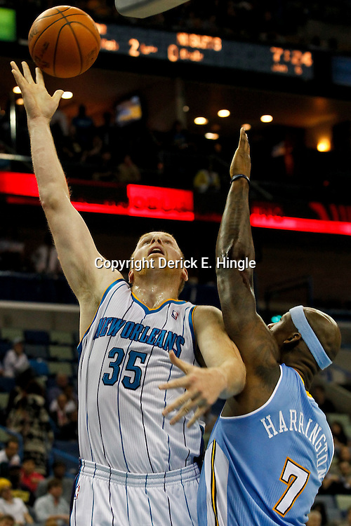 January 6, 2012; New Orleans, LA, USA; New Orleans Hornets center Chris Kaman (35) shoots over Denver Nuggets power forward Al Harrington (7) during the first quarter of a game at the New Orleans Arena.   Mandatory Credit: Derick E. Hingle-US PRESSWIRE