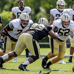 Jul 28, 2019; Metairie, LA, USA; New Orleans Saints offensive tackle Ryan Ramczyk (71) and center Nick Easton (62) work against New Orleans Saints defensive tackle David Onyemata (93) during training camp at the Ochsner Sports Performance Center. Mandatory Credit: Derick E. Hingle-USA TODAY Sports