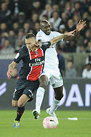 FOOTBALL - FRENCH CHAMPIONSHIP 2011/2012 - L1 - PARIS SAINT GERMAIN v OLYMPIQUE MARSEILLE - 8/04/2012 - PHOTO JEAN MARIE HERVIO / REGAMEDIA / DPPI - JEREMY MENEZ (PSG) / ALOU DIARRA (OM)