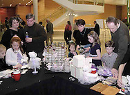 Ballet watchers turn into merchandise customers during intermission of the Wintergreen area of the Schuster Performing Arts Center, Saturday night, March 17th.  John Woeste (right,) from Miamisburg and son Kevin, 7, look at items as his wife Nancy (4th from right) looks with Michelle, 4, and Rachel, 10.