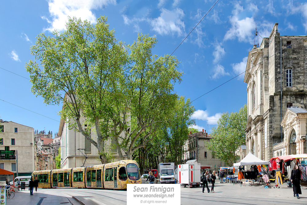 A tram passing through the busy Place Albert 1er square in the centre of Montpellier.  The square was originally named Place de l'Hôpital Général when built by King Louis XIV in 1662. It was renamed Albert 1er in honour of the King of the Belgium for his participation in the First World War.