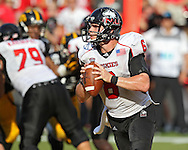 August 31 2013: Northern Illinois Huskies quarterback Jordan Lynch (6) rolls out to pass during the second half of the NCAA football game between the Northern Illinois Huskies and the Iowa Hawkeyes at Kinnick Stadium in Iowa City, Iowa on August 31, 2013. Northern Illinois defeated Iowa 30-27.