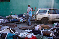 Thousands of bodies lay on the street at the General Hospital in downtown Port-au-Prince to transport them to a common grave in Haiti on Friday January 15, 2010.