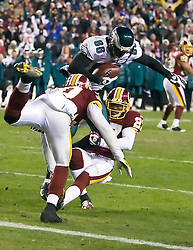 Washington Redskins safety LaRon Landry (30) and cornerback Fred Smoot (27) stop Philadelphia Eagles wide receiver Reggie Brown (86) on the final play of the game at the 1 yard line.  The Washington Redskins defeated the Philadelphia Eagles 10-3 in an NFL football game held at Fedex Field in Landover, Maryland on Sunday, December 21, 2008.
