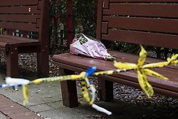 © Licensed to London News Pictures . FILE PICTURE DATED 27/11/2016 . Manchester , UK . Flowers left at the scene outside a gutted building on the corner of Faulkner Street and Nicholas Street in Manchester's China Town , following a fatal fire as this evening (5th December 2016) Greater Manchester Police have launched a murder investigation into the deaths of James Evans (57) and Wayne Bardsley (51) , who died at the scene . Photo credit : Joel Goodman/LNP