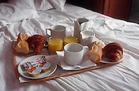 May  1988, Paris, France --- Paris Breakfast on Bed --- Image by © Owen Franken/CORBIS
