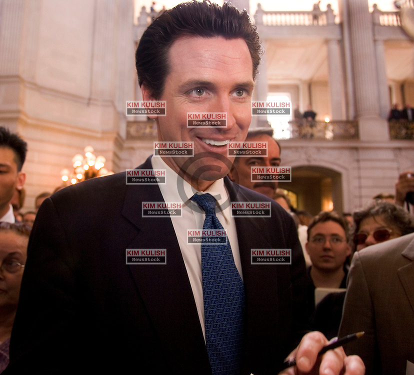 San Francisco Mayor Gavin Newsom smiles as he works his way through the crowd following his address to over a thousand gay  couples on the one-year anniversary of San Francisco's same-sex weddings inside City Hall Saturday, Feb. 12, 2005.   Newsom urged  the crowd to continue the fight for marriage equality. Photo By Kim Kulish