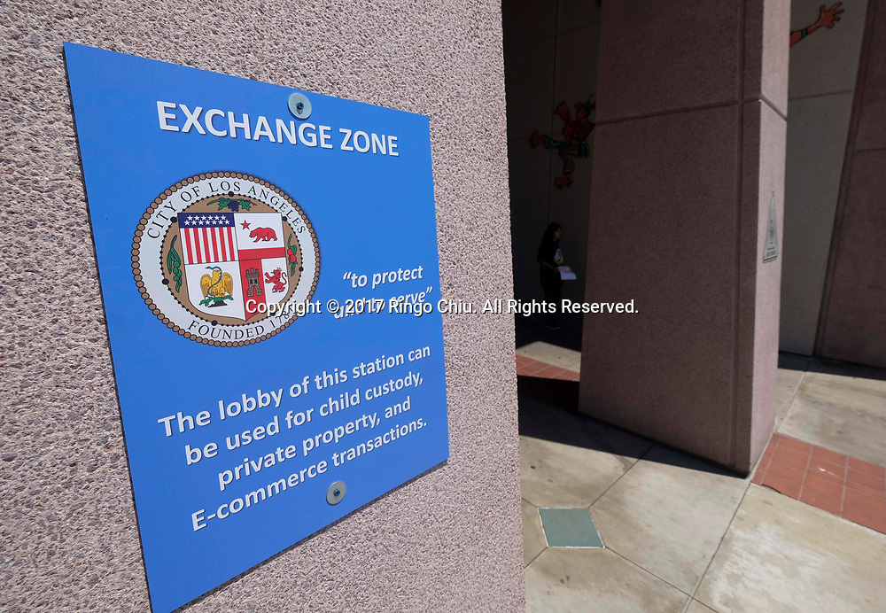 An &quot;Exchange Zone&quot; is displayed at the 77th Street Police Station on June 29, 2017 in Los Angeles, the United States. Los Angeles Police Department on Tuesday unveiled an ``e-commerce exchange zones'' program in which people who buy or sell items via internet sites such as Craigslist may conduct the transactions in the lobbies of nine police stations. The transactions can occur seven days a week at all hours, and will be conducted in the lobby areas only. No firearms or illegal items will be allowed. (Photo by Ringo Chiu)<br /> <br /> Usage Notes: This content is intended for editorial use only. For other uses, additional clearances may be required.