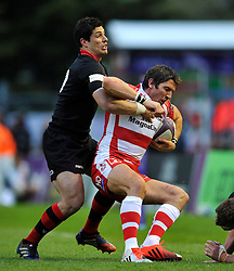 James Hook of Gloucester Rugby  is tackled - Photo mandatory by-line: Patrick Khachfe/JMP - Mobile: 07966 386802 01/05/2015 - SPORT - RUGBY UNION - London - The Twickenham Stoop - Edinburgh Rugby v Gloucester Rugby - European Rugby Challenge Cup Final