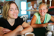 CAYE CAULKER, : March 12, 2006 -- CAYE CAULKER, BELIZE --  Flavia Ferrero (L) and Julie Jezierski enjoy breakfast in a small restaurant in  Caye Caulker, a small island off Belize March 12....Steve McKinley Photo.