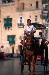 MALTA VALETTA JUL00 - A Carozzin, a horse-drawn cart, nowadays applied mainly for the amusement of tourists, roams the streets of Valetta.....jre/Photo by Jiri Rezac....© Jiri Rezac 2000....Tel:   +44 (0) 7050 110 417..Email: info@jirirezac.com..Web:   www.jirirezac.com