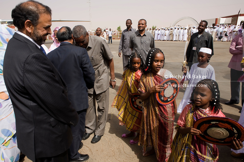 British Labour peer, Lord Ahmed of Rotherham admires the children of Darfur who along with digitaries and officials, greet his delegration at Al Fashir airport, Sudan. Nazir, Baron Ahmed (born 1958) is a member of the House of Lords, having become the United Kingdom's first Muslim life peer in 1998 and is in this war-torn province of Sudan to attend the first-ever international Conference on Womens' Challenge in Darfur, hosted by the govenor in his own compound.
