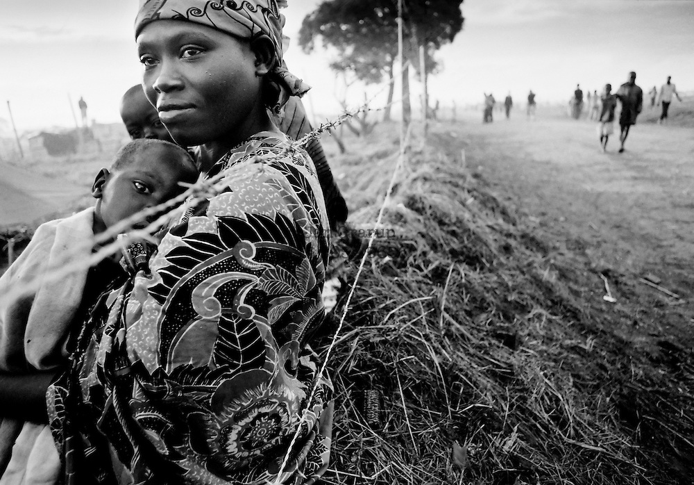 A Tutsi mother and her children in a red cross camp on the border between Tanzania and Rwanda. Apr. 1994 -<br /> The sun had set over the rwandan capital Kigali as president Juvenal Habyarimana's plane approached the city's airport on 6.april 1994.Suddenly, out of the darkness, a rocket hit the plane and sent it crashing to the ground, killing everyone on board.over the next three month's, more than 800.000 rwandans would be murdered, many cut down with machetes, killed by neighbours and countrymen, in a ferocious ethnic genocide that was all but ignored by the international world.