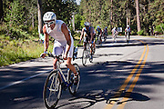 Arthur Shoenstadt of Issaquah, Washington struggles during a tough climb along the backstretch of the 112 mile bike section in the Hayden area...