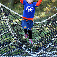 Adam Robison | BUY AT PHOTOS.DJOURNAL.COM<br /> Megan Cappleman, 5, leaps from the top of the giant sipder web as she plays at the pumpkin patch. The giant spider web was a new addition at the pumpkin patch this year.