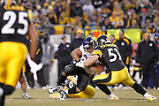 James Farrior (51) of the Pittsburgh Steelers makes a hard hit on Ray Rice (27) of the Baltimore Ravens in the AFC Divisional Playoff game on Jan. 15, 2011 at Heinz Field in Pittsburgh, Pennsylvania. The Steelers won 31-24. (Photo by Joe Robbins)