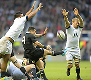 Twickenham, United Kingdom, left Billy VUNIPOLA and right, Chris ROBSHAW attempt to charge down Arron SMITH's clearance kick during the 2013 QBE  AutumnRugby International, England vs New Zealand, played  Saturday  16/11/2013 at the RFU Stadium Twickenham,<br /> England. [Mandatory Credit: Peter Spurrier/Intersport<br /> Images}