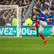 PARIS, FRANCE - March 25:  Antoine Griezmann #7 of France kicks the ball away in frustration over the referee's decision and was booked for his indiscretion during the France V Iceland, 2020 European Championship Qualifying, Group Stage at  Stade de France on March 25th 2019 in Paris, France (Photo by Tim Clayton/Corbis via Getty Images)